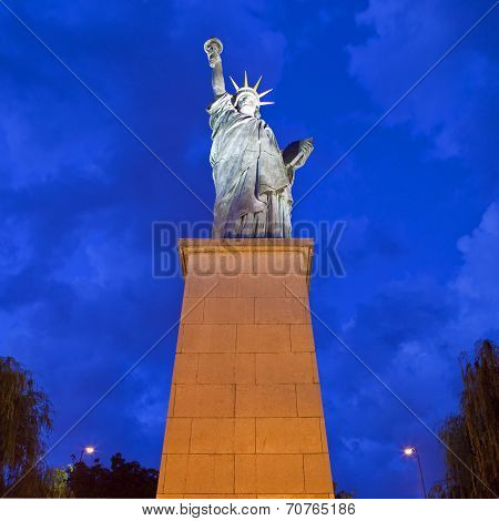 A replica of the iconic Statue of Liberty monument located by the Grenelle Bridge on the river Seine in Paris. poster