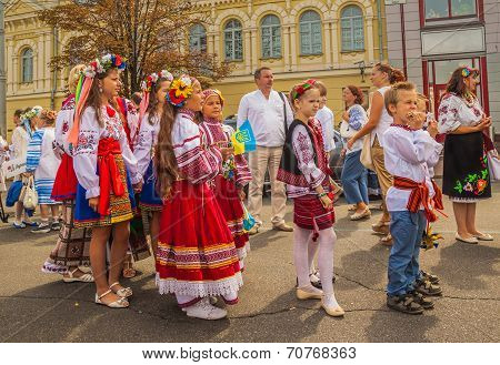 Children-twins In The National Traditional Costumes Of Their Regions In The Parade Of Embroidery