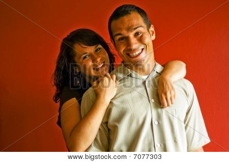 Young Attractive Adult Couple Relationship Hugging In Love Smiling