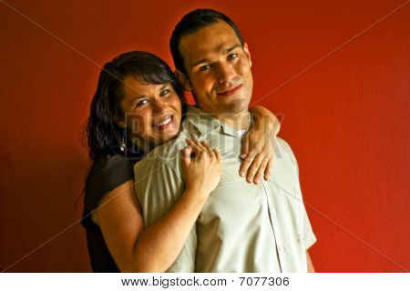 Young Attractive Adult Couple Relationship In Love Hugging