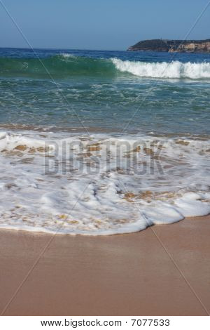 Waves Breaking On The Sea Shore