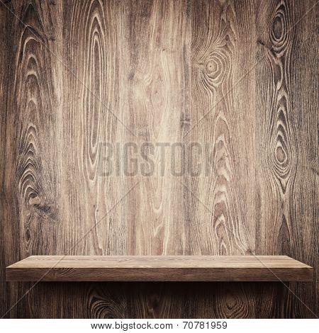 Empty shelf on wooden wall