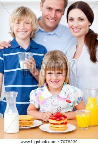 Joyful Family Eating Breakfast In The Kitchen