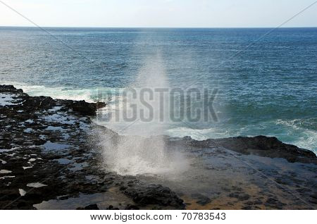 Water Shooting Upward From Spouting Horn Blowhole Kauai Hawaii