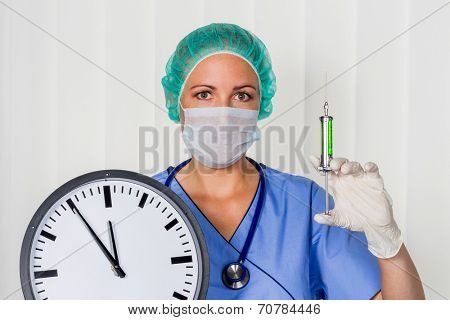 a nurse or doctor in surgical clothes before surgery. symbol photo for stress and overtime at the hospital. poster