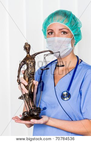 a nurse or doctor in surgical clothes before surgery. symbol photo for work in the hospital