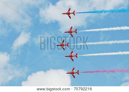 EASTBOURNE, ENGLAND - AUGUST 14, 2014: RAF aerobatic team The Red Arrows perform at the annual Airbourne airshow. Formed in 1965, the team are in their 50th display season.