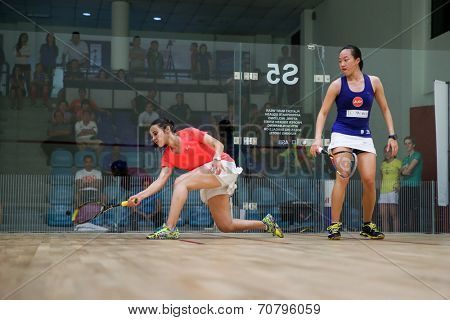 AUGUST 19, 2014 - KUALA LUMPUR, MALAYSIA: Heba El Torky of Egypt (red) rushes forward to hit a return in her match against Low Wee Wern of Malaysia in the CIMB Malaysian Open Squash Championship 2014.