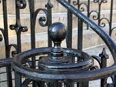 black iron spiral handrail at bottom of staircase  at park street church in boston massachusetts poster