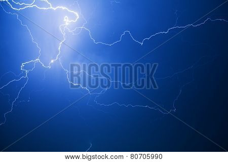 Blue lightning strike at night