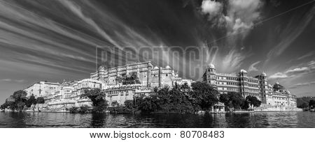 India luxury tourism concept background - panorama of Udaipur City Palace from Lake Pichola. Udaipur, India. Black and white version poster
