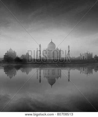 Taj Mahal with reflection in Yamuna river in fog, Indian Symbol - India travel background. Agra, Uttar Pradesh, India. Black and white version poster