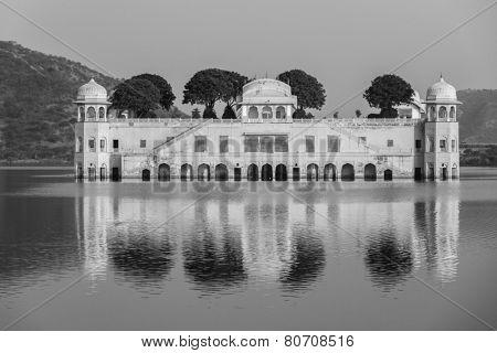 Rajasthan landmark - Jal Mahal (Water Palace) on Man Sagar Lake on sunset.  Jaipur, Rajasthan, India. Black and white version