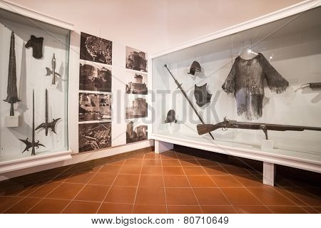 DUBROVNIK, CROATIA - MAY 27, 2014: Weapons exhibit in the Cultural Historical Museum inside the Rectors Palace. The majority of the halls have styled furniture to recreate the original atmosphere