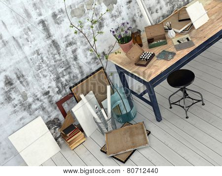 3D Rendering of Interior of an artist or designer studio with blank canvasses, picture frames and supplies on a simple black wood work table with a stool against an abstract patterned grey wall