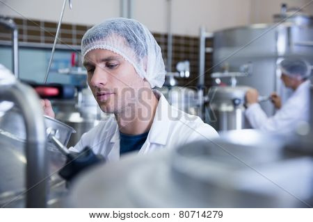 Close up of a man wearing a hair net in the factory