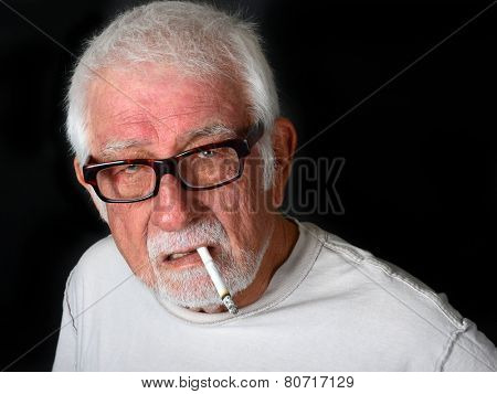Elderly man smoking a cigarette with an angry and upset look on his face