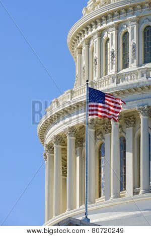 US Capitol Building dome detail with waving national flag - Washington DC, United States of America poster