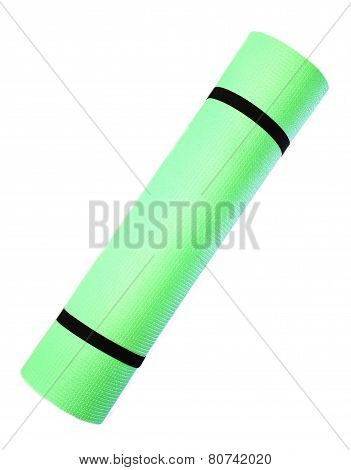 Lightweight foam Yoga Mat roll isolated on white background.