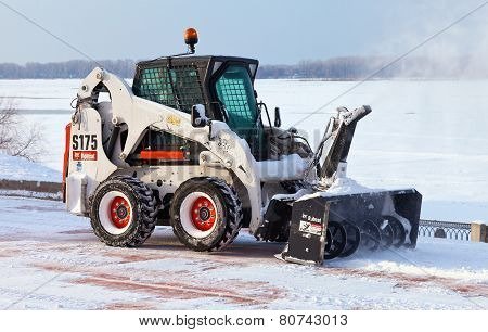 Snow Cleaning Pavements And Streets Of City Which Are Covered In Snow During Heavy Snowfall