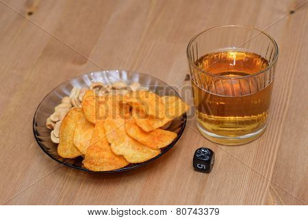 Unhealthy Snacks On Table With Skull Dice