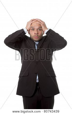Surprised Hispanic Businessman In Stress And Shock Wearing Suit And Tie Looking Scared, Clueless And