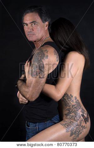 Nude Woman Embracing Man