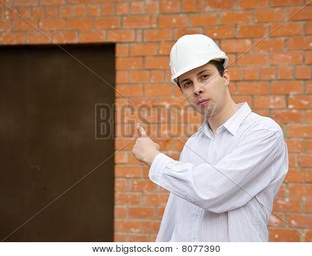 Builder Pointing To Door