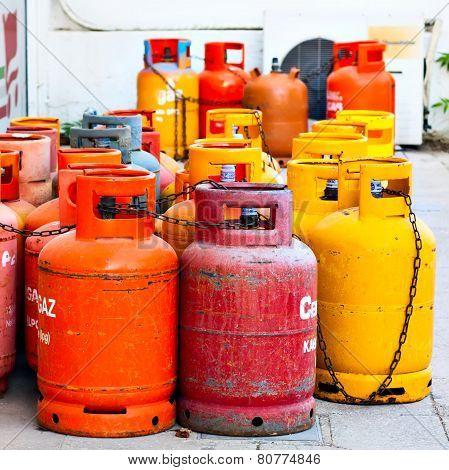 Old used gas bottles cylinders storage. Propane, butane.