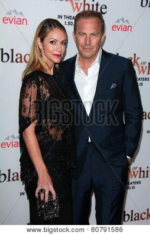 LOS ANGELES - JAN 20:  Christine Baumgartner, Kevin Costner at the
