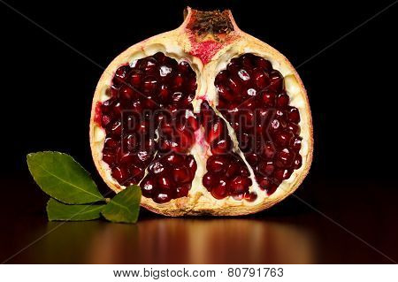 Half-cutted Pomegranate With Green Leaf
