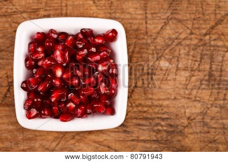 Red Grenadine Seeds On White Plate