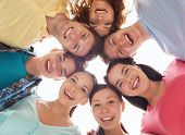 friendship, youth and people - group of smiling teenagers in circle poster