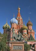 Monument citizen Minin and Prince Pozharsky against the background of St. Basil's Cathedral on Red Square poster