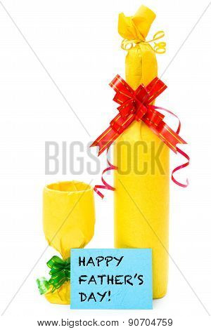Wrapped Wine And Cup And Card For Texts On A White Background