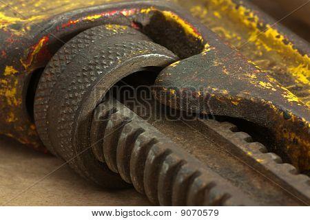 Macro Of Grunge Pipe Wrench Adjustment Wheel + Gear. Shallow Dof.