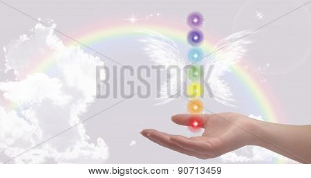 Healing Hands and seven chakras on a sparkling pastel coloured background poster