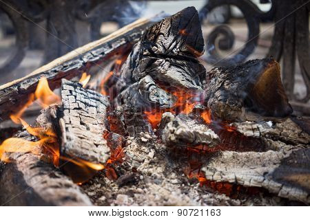 Burning Smoldering Firewood In The Fireplace Close Up. Firewood. Coals. Extinguished The Fire. The A