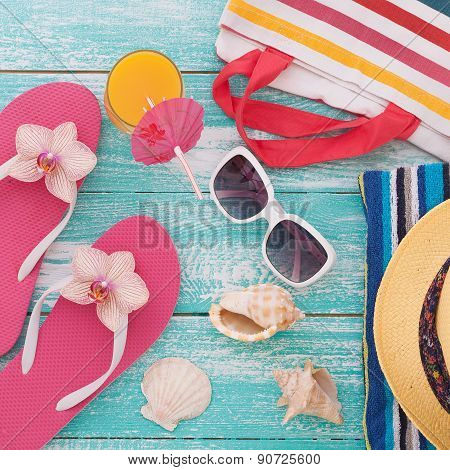Summer Holidays. Beachwear on wooden background.