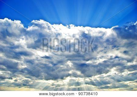 the Sun's Rays Breaking Through The Dark Rain Clouds