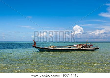 NOVEMBER 11, 2011 - SABAH, MALAYSIA: An unidentified sea gypsy man takes a boat out to sea on a fishing trip near Mabul Island, Sabah, Malaysia.