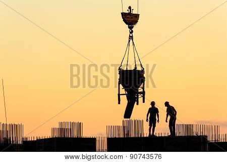Silhouettes of builders at sunset