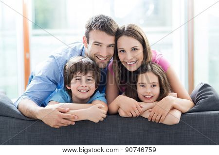 Family relaxing on sofa