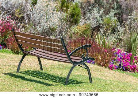 Rustic Bench Between Flowers