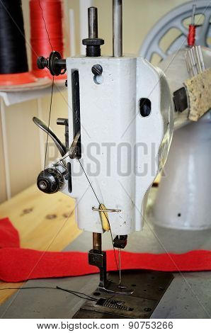 Old Sewing Machine In The Sewing Studio . Side View, Close Up, Vert
