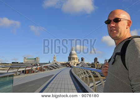 Tourist on Millenium Bridge