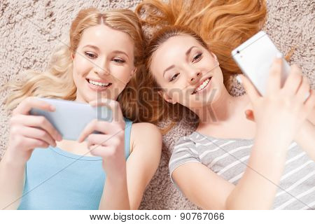 Two young girls on the floor