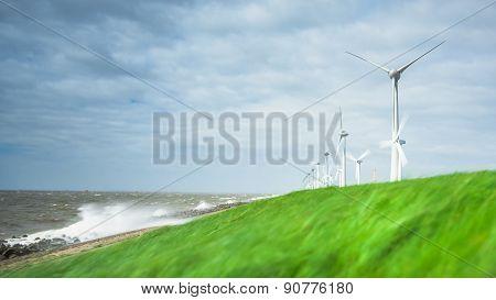 Wind Farm Along The Dike Of The Noordoostpolder In The Netherlands