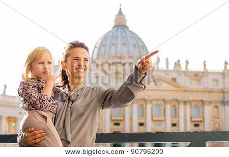 In Vatican City In Rome, Smiling And Pointing Mum Holding Child