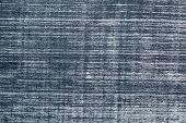 background texture of white chalk smudges on black slate blackboard poster